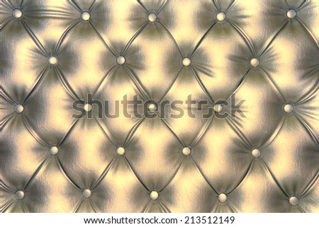 Luxurious shiny-gold tone leather texture furniture with buttons - stock photo
