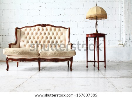 Luxurious sofa in vintage room - stock photo