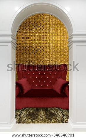 luxurious sofa  with graceful columns and arches  - stock photo