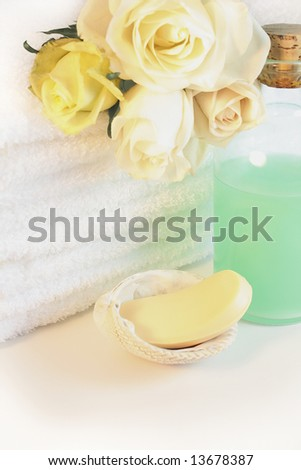 Luxurious spa towels with white and yellow roses - stock photo