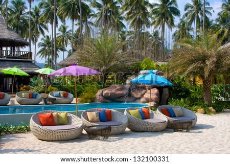 Luxurious swimming pool in a tropical garden, Thailand. - stock photo