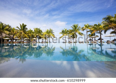 Luxurious swimming pool of a five stars holiday resort on tropical paradise island of Mauritius