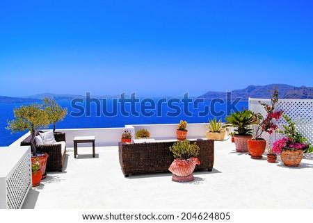 Luxurious terrace overlooking the sea on the island of Santorini, Greece - stock photo