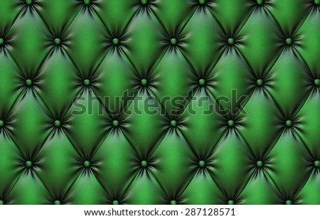 luxurious texture of green leather upholstery. - stock photo