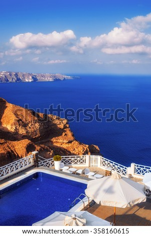 Luxurious villa with a view of the caldera, Santorini island, Greece - stock photo
