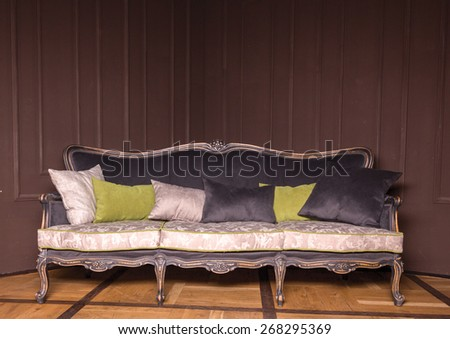 luxurious white and black sofa with pillows on a brown background