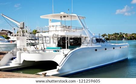 Luxurious white catamaran in the port in Dominican Republic - stock photo