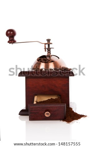 Luxurious wooden coffee mill with coffee beans and ground coffee. Culinary coffee drinking. Fresh aromatic coffee.