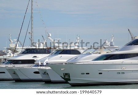 Luxurious yachts are anchored along the waterfront of Kaohsiung harbor in Taiwan - stock photo