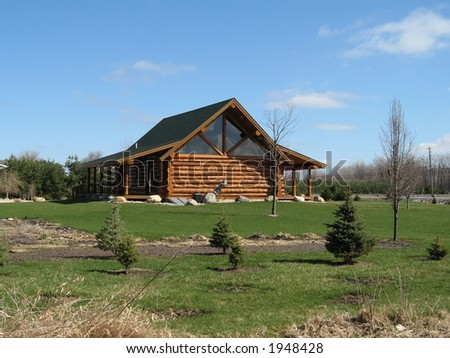 Luxuriously expensive log cabin home - stock photo