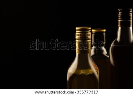 luxury alcoholic drinks  with empty space on dark background - stock photo