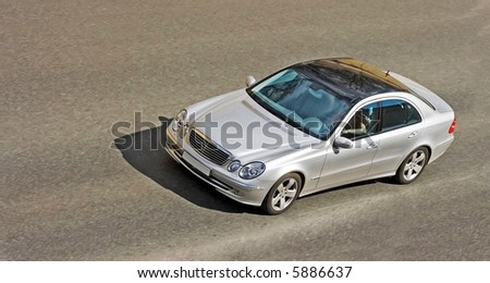 Luxury and power: silver German car speed fast crisp sharp image.  See many similar quality images in my portfolio - stock photo