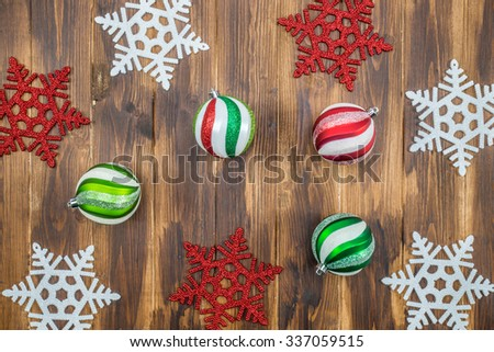 Luxury and  shiny Christmas ball with  snowflakes on wooden background