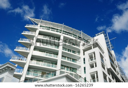 luxury apartment exterior with blue sky background - stock photo