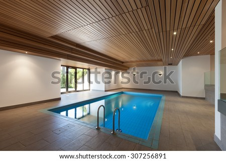 luxury apartment with indoor pool, wooden ceiling - stock photo