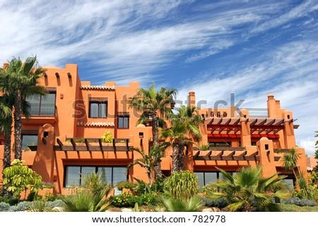 Luxury apartments and gardens on new, sunny urbanisation in Puerto Banus, Spain - stock photo