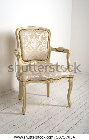 luxury armchair in a plain white interior - stock photo