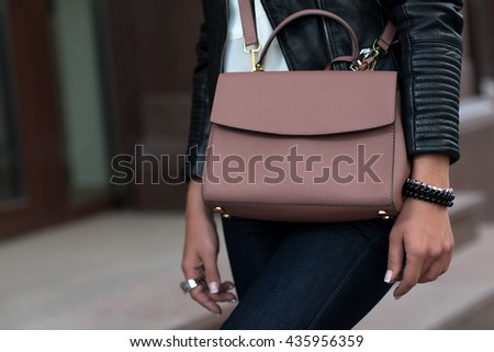 Luxury bag. Stylish and fashionable woman holds glamorous female leather bag. Sales bag fashion concept