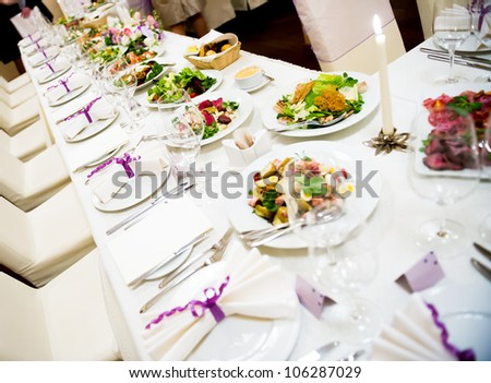 Luxury banquet table setting in restaurant - stock photo