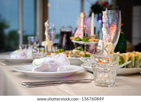 Luxury banquet table setting in restaurant close-up - stock photo