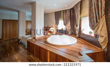 luxury bathroom interior complete with granite and beautiful tiled floors and walls. - stock photo