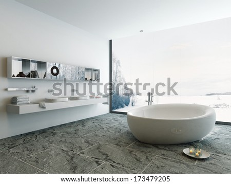 Luxury bathroom interior with bathtub and stone floor - stock photo