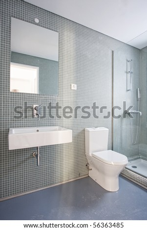 Luxury bathroom interior with brown tiles at a new home - stock photo