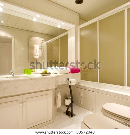 Luxury bathroom with brown tiles - stock photo