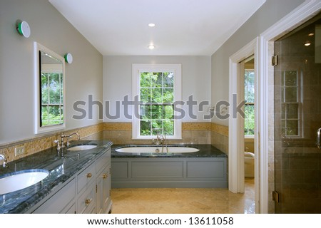 Luxury bathroom with separated shower and toilet rooms - stock photo