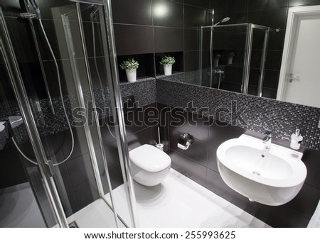 Luxury bathroom with shower in modern house - stock photo