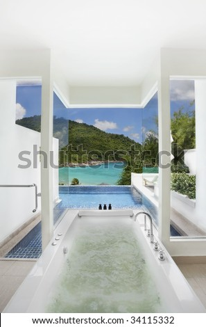 luxury bathroom with swimming pool and sea view - stock photo