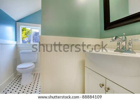 Luxury bathroom with white tiles and blue walls. - stock photo