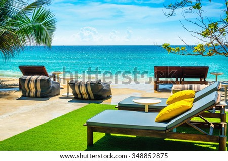 Luxury beach chairs against the azure waters abounding the Andaman Islands , Phuket, Thailand, South Asia - stock photo