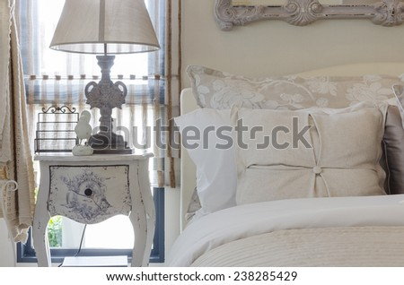 luxury bed with pillows and table side at home - stock photo