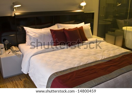 Luxury bedroom in a five star hotel an night time - stock photo
