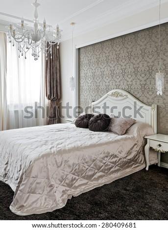 Luxury bedroom interior in classic style - stock photo