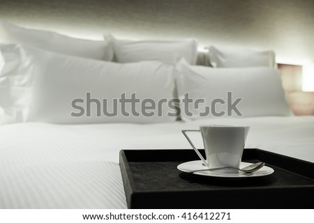 luxury bedroom / living room with a cup of coffee.