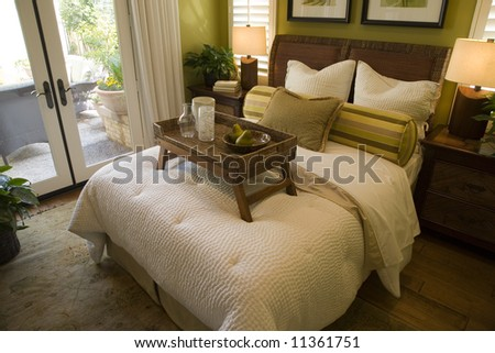 Luxury bedroom with a bed tray. - stock photo