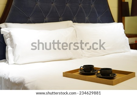 luxury bedroom with cup of coffee. - stock photo