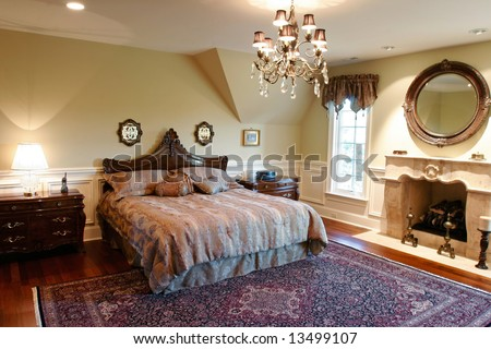 Luxury Bedroom with fine bedding furniture and textiles - stock photo
