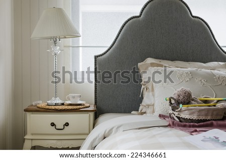 luxury bedroom with lamp on table and set of crochet - stock photo