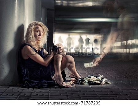 luxury beggar girl is sitting on the floor in subway - stock photo