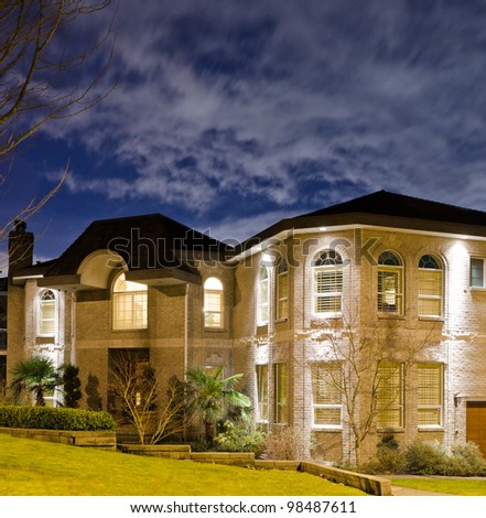Luxury big house in suburbs at dusk ( night ) in Vancouver, Canada - stock photo