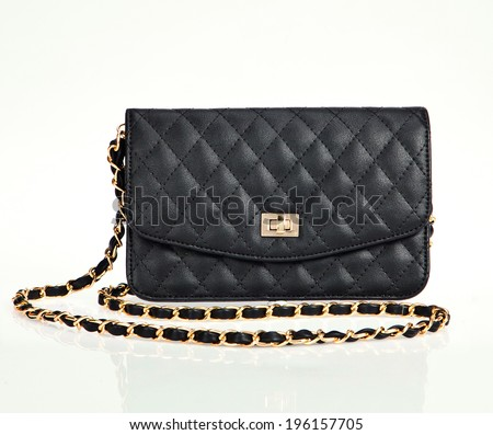 Luxury black women bag isolated over white - stock photo