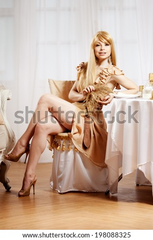 Luxury blonde in interior New Year. Young beauty trendy girl celebrating Christmas. Friendly woman - stock photo