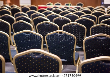 Luxury blue and gold chairs on a conference - stock photo