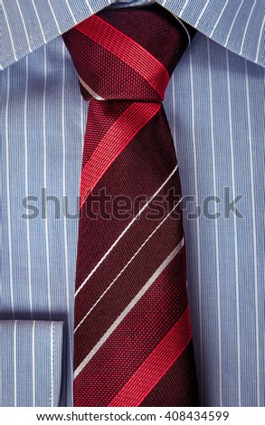 Detail bike wheel red tiles imagen de archivo stock for Blue striped shirt with tie