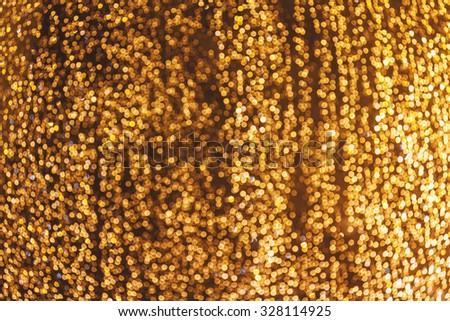 Luxury blurred background with bokeh stream of golden rain - stock photo