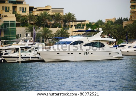 luxury boat docked in Dubai Marina - stock photo