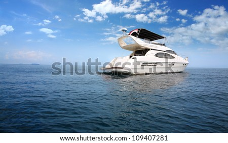 Luxury boat in the middle of the ocean - stock photo